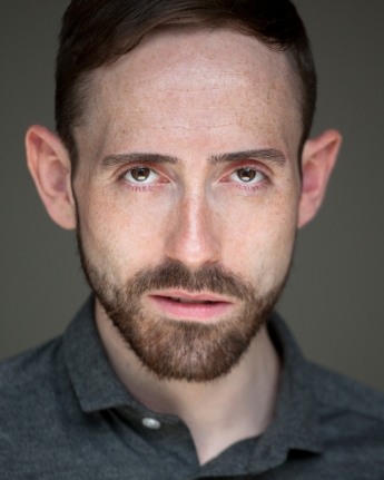 Headshot by Simon Annand
